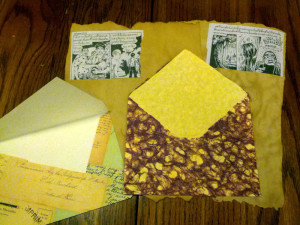 """A couple envelopes I made, some """"aged"""" writing paper using Thai comics."""